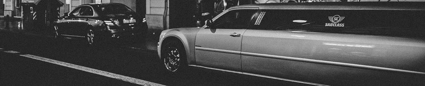 A black and white picture of a limousine